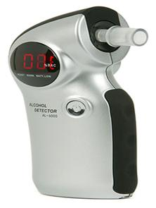 A hand-held breath tester that a user can blow into and receive a digital numeric reading from.