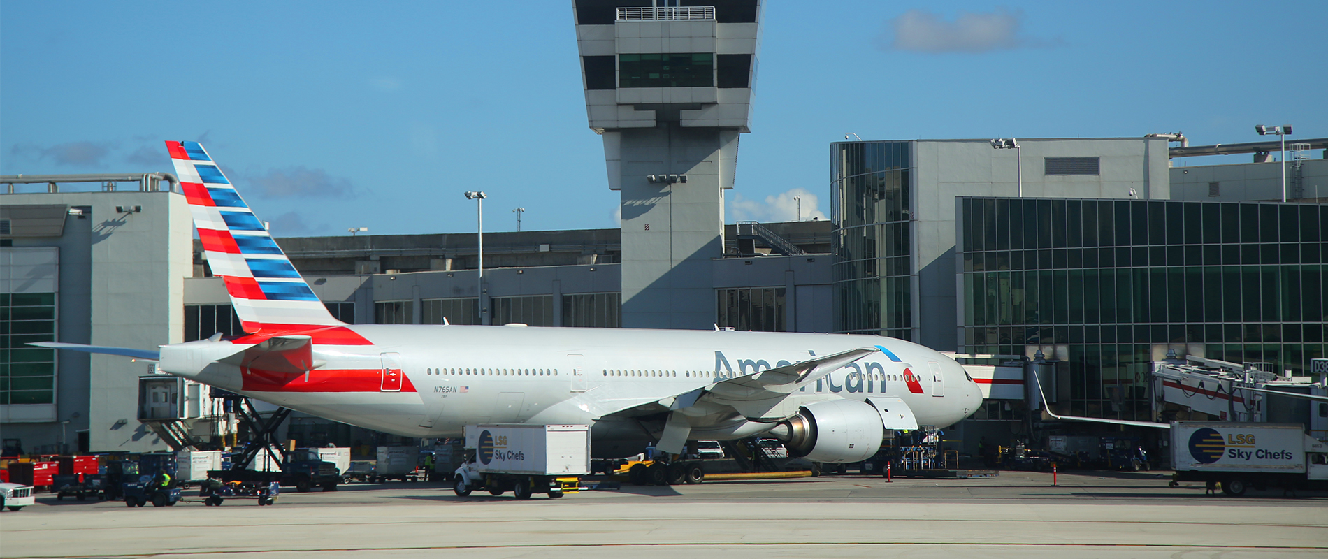 American Airline plane sits outside an air traffic control tower