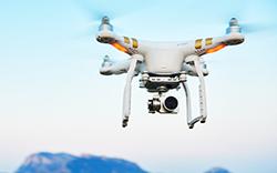 A drone flying near an island.