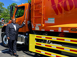 Greg Winfree stands next to a Cambridge Department of Public Works truck that is outfitted with side guards.