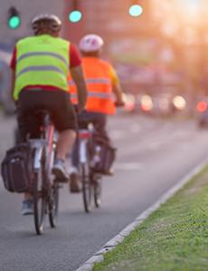 Cyclists biking in a bike lane