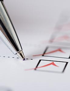 A pen next to a checklist