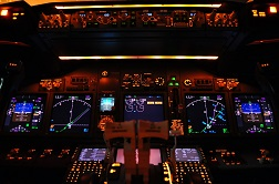 The instrument panel of a modern Boeing 737-800 airliner at night.