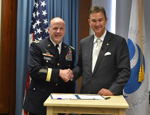 General Stephen Lyons and Joel Szabat shake hands at the Volpe Center following the signing of the updated MOU.
