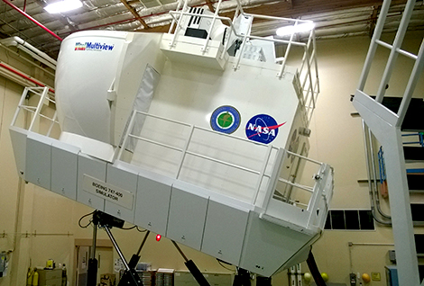 "A photo of a simulator cab at NASA Ames tilting upwards to create a ""pitch-up"" scenario that is known to cause spatial disorient"