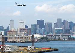 An airplane flying over Boston near Boston Logan International Airport