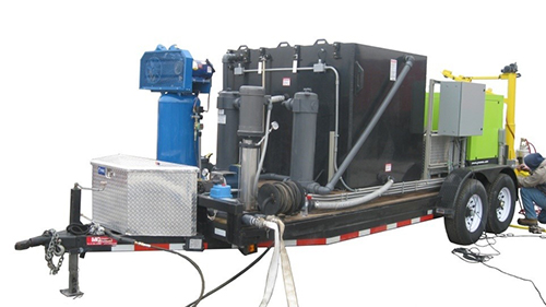 The DOTWASH system, which sits on a trailer and can be towed behind a pickup truck.