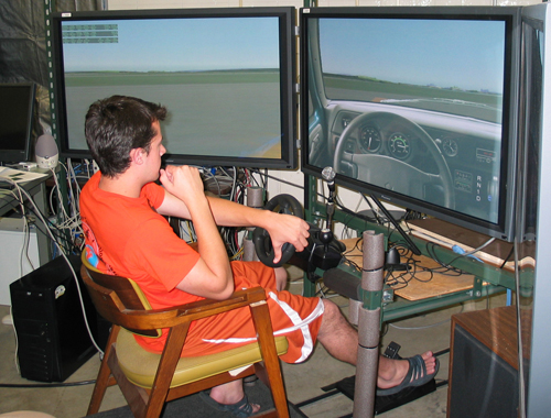 A Summer Transportation Institute student viewing a simulator screen