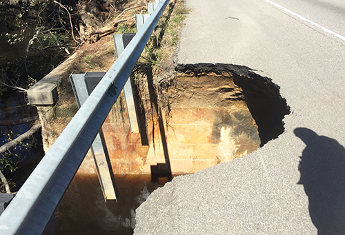 Image of a portion of a highway that collapsed due to Hurricane Matthew.