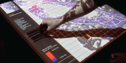 A person interacts with a map visual interface to estimate freight logistics.