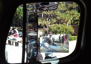 Three side mirror types and a Fresnel lens, all designed to mitigate the right-side blind spot of a large truck, were viewable by demo attendees from the driver's seat of a Boston DPW truck.