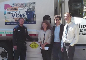 Rob Pardo (Boston DPW) and Volpe staff stand in front of a truck with a side guard.