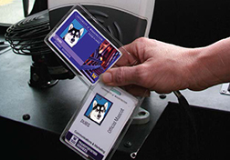 Close-cropped image of someone holding the University of Washington's student ID cards, the Husky card.