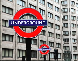 A sign featuring London's Underground transit logo.