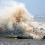 Hurricane blowing sea water against a shoreline