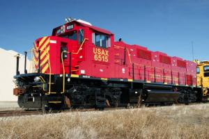 A locomotive on a set of railroad tracks.