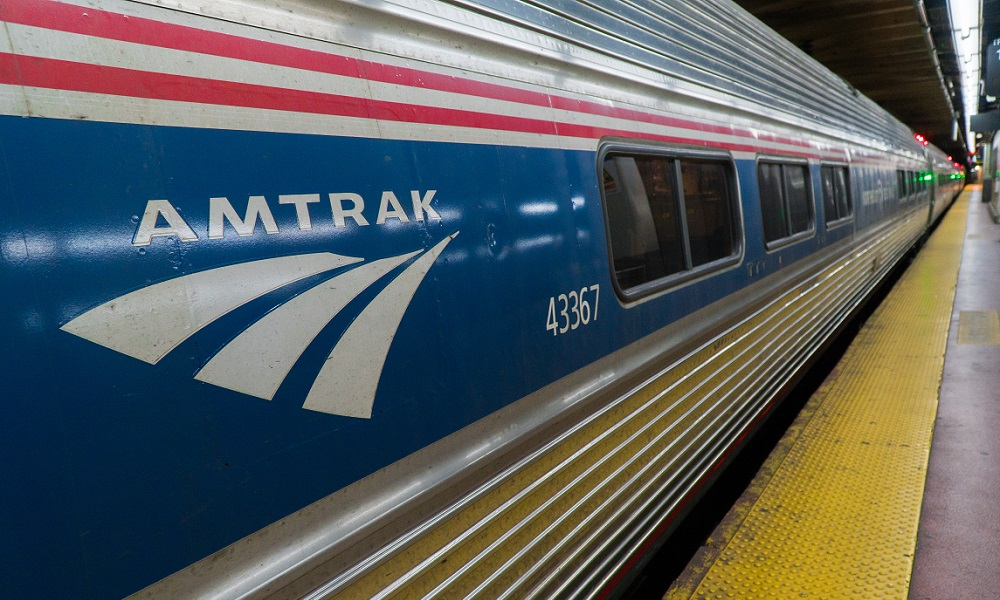 An Amtrak train stopped at a passenger platform.
