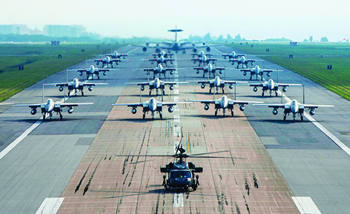 U.S. military planes lined up in formation on a tarmac