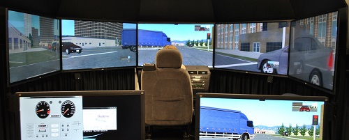 A woman sits in the driver's seat of Volpe's new driving simulator.