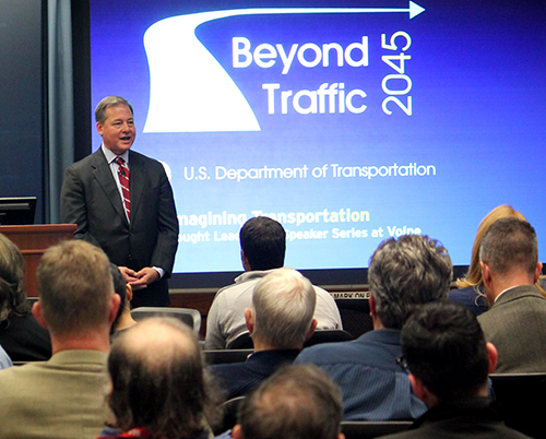 Harry Lightsey speaks to a crowd at Volpe during his talk for Beyond Traffic 2045: Reimagining Transportation.