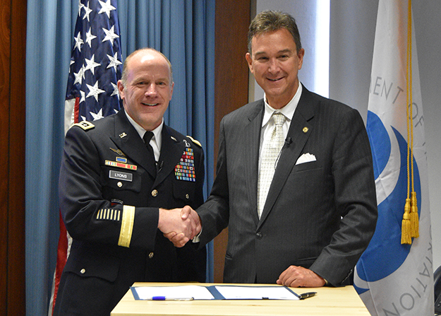 General Stephen R. Lyons and Acting Under Secretary of Transportation Joel Szabat shake hands at the Volpe Center following the signing of the updated MOU.