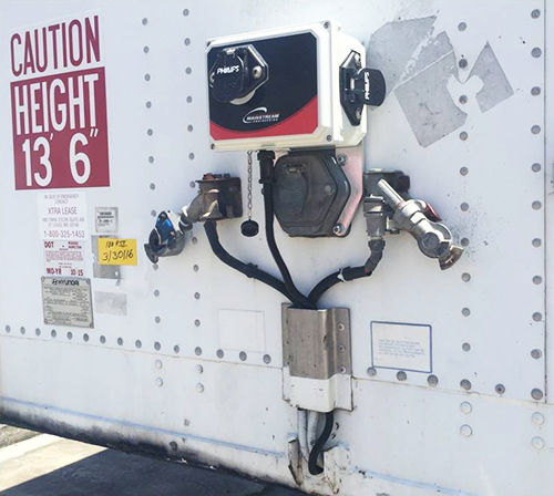 An Ottobon device is installed on the side of a tractor-trailer.
