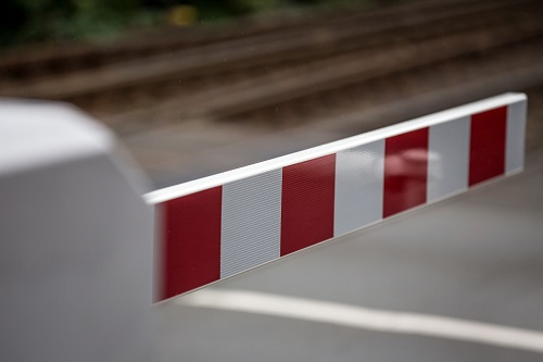 A closed railroad crossing gate.