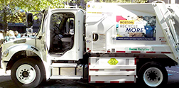A photo of a Boston Public Works truck with sideguards installed.