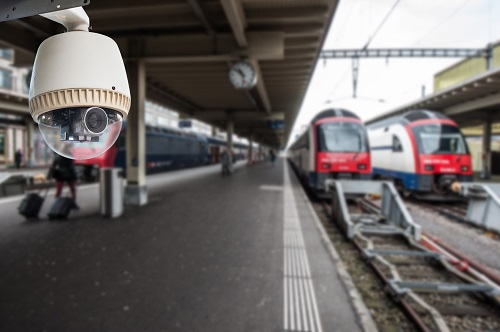 A surveillance camera monitors a train station.