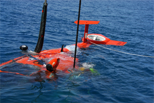 Retrieving the downed HH-65 helicopter from the ocean after the fatal explosion over the water. (U.S. Coast Guard photo)