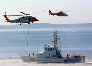 U.S. Coast Guard performs a small boat/helicopter hoist exercise. (U.S. Coast Guard photo)