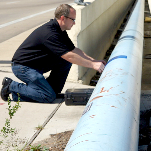 A man tests a pipeline.