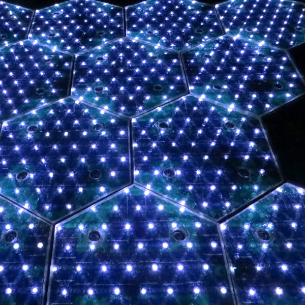 Hexagonal, lit-up solar road panels.