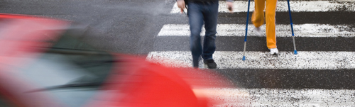 Two people in crosswalk cut off by speeding car. (aaron007 / 123RF Stock Photo)