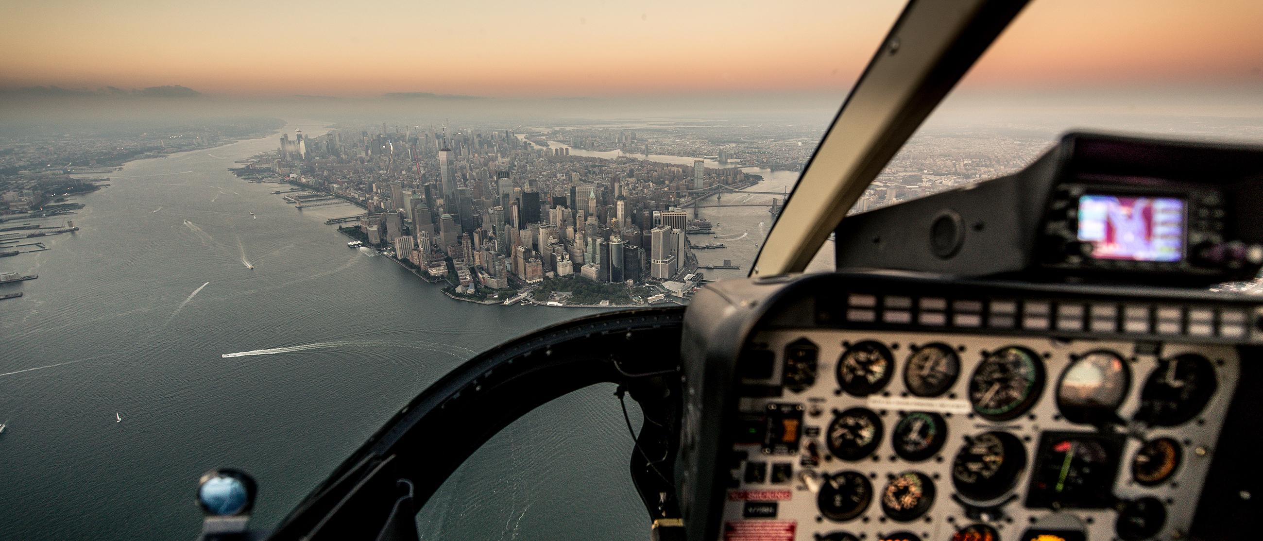 A view of New York City from inside a helicopter.