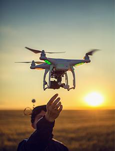 a pilot flies a drone